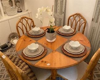 Pine round dining table and 4 rattan chairs sold separately