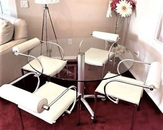 Chrome & Glass Dining set w/floating backrest leather chairs