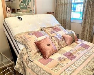 Newer Full Matress with electric headboard. Bedroom bedding and matching drapes.