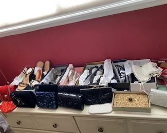 Clutch purses and many never worn shoes in boxes