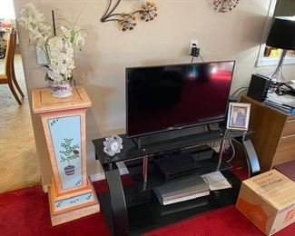 """42"""" HDTV and Black Glass TV Stand"""