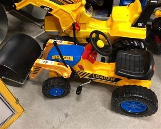 Many ride on and pedal vehicles for kids, including these  front end loaders.