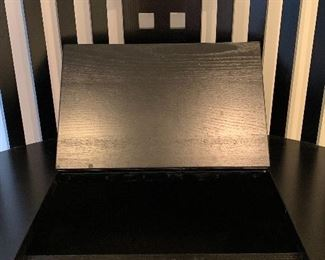detail (seat provides storage inside)