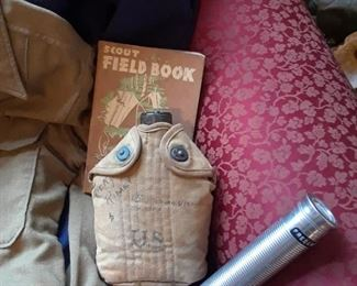 Canteen, flashlight, and Boy Scout field book