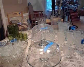 Cake plates, punch  bowl with cups, pitchers, and other glassware