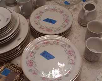 Set of porcelain dinner plates and salad plates