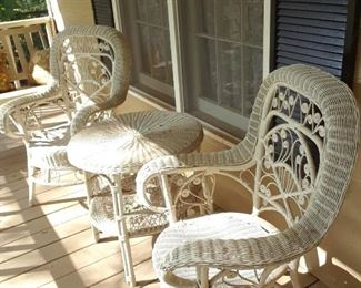 Pair of vintage wicker arm chairs and table