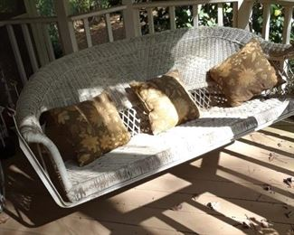 Wicker porch swing