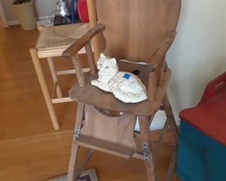 High chair and cast iron cat
