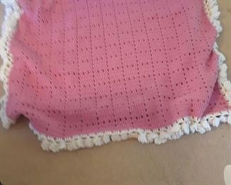 Crocheted afgan in pink with ruffled border