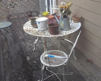 Wrought iron table and cafe chairs