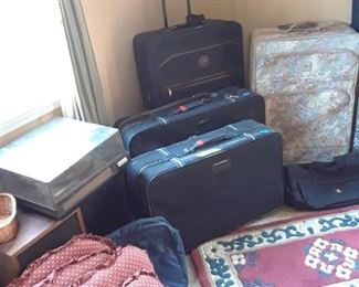 Chair cushions, area rug, luggage, another turntable