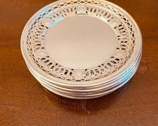 Antique sterling silver reticulated side plates. Set of 12.