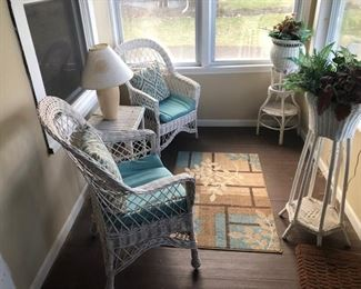 Four (4) wicker chairs, three (3) planters, (2) tables and lamps, area carpets