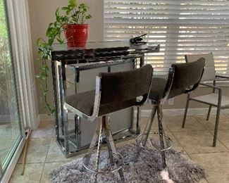 $725 ~ CHROME ROTATING BAR WITH TWO BAR STOOLS