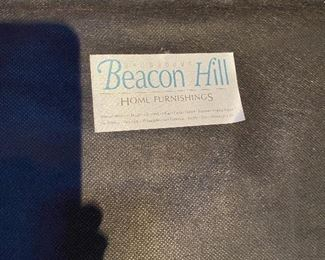 Picture of the Beacon Hill tag on the chair and ottoman