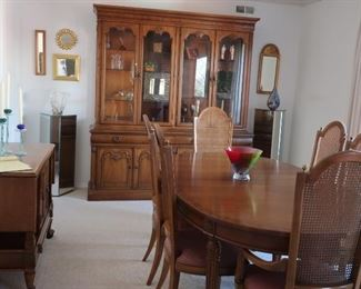 "16.      dining  room set with china cabinet, server, table and six chairs. The table has pads and three leaves.  Table is 45 x 66 width w/o leaves..  The  leaves   are  12""  each. China cabinet is 6'11  in height and 75""  wide. Server  is 3'6"" wide with two flip over sides of 13""each  it  is  18"" deep   The  pieces  can  be  purchased  individually.     Total  cost  is   595.00"