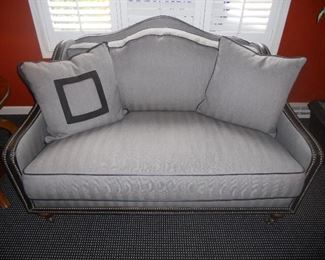 Loveseat by Michael Thomas Furniture with leather trim and nailheads