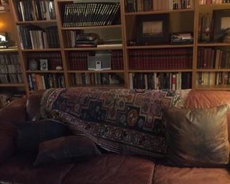 Overview of books -leather couch-tribal carpet