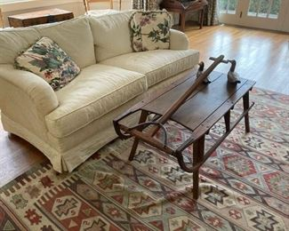 White loveseat - Antique sled made into table