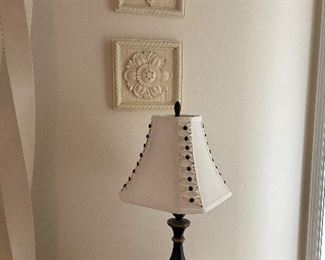 5. Pair of mismatched lamps and 4 wall reliefs and one print $75