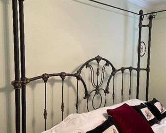 9. Iron post bed with curtain rods for privacy in this bed (or a mosquito net!).  Includes table on side as well.  No wall hangings included.  Kiler style. King Size!  $495