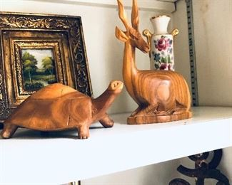 hand carved antelope and turtle