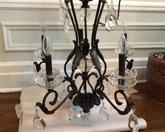 "Metal chandelier with crystal accents. 45"" deep X 24"" wide. $250"