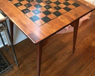 "Wooden chess/checkers table. 26"" high X 24"" square. Some condition issues to top. $25"