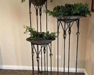 """LOT 6614 Set of three small, medium and large plant stands. Sizes are 3'2"""" - 4'2"""" - 5'3"""" Black with brass accents $400 for set"""