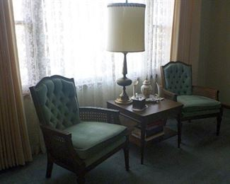 Mid Century matching arm chairs with cane sides and tufted backs.  The walnut end table matches the coffee table.