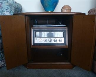 Magnavox built it cabinet.  Working photograph and radio.