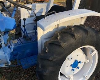 #0)  $3000 - Ford 1600  Diesel Farm Tractor.  Model A1012T Serial #U111288.  2WD, 23 HP, 540 Rear PTO 3Pt Hitch, Sold with a 60 inch blade with Hydrolic Lift.  Sold with a plow attachment.  Six forward gears, 2 reverse gears, Rear auxiliary hydraulic.  Runs well.