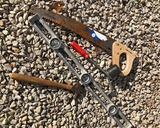 #19) $20 - Lot of miscellaneous tools, 24-inch fiskar saw, 3-foot level, hammer, and tire tool