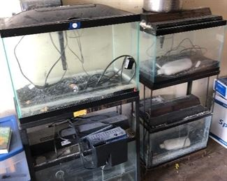 #35) $150 All - Aquarium equipment including four aquariums, two 8-gallon and two 20-gallon aquariums with stands, books, and assorted equipment