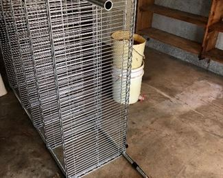 #61) $20 - Stainless Steel Food Service Shelf.  No Casters.  48 inches wide by 15 inches deep.  A little rust or corrosion on one leg and shelf.