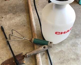 #62) $15 - Sprayer, hoe, garden tools.