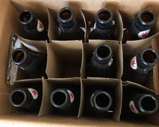 #73) $25 - 13 cases of beer bottles for beer making apparatus.