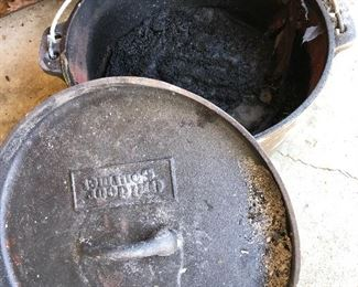 #75) $15 - Cast iron dutch oven with lid.