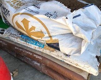 #83) $10 - Four bags of peat moss potting soil.