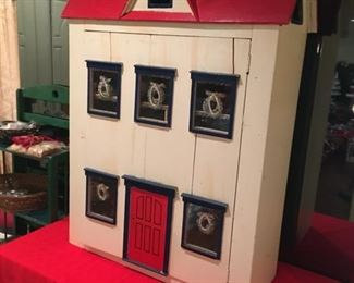 Christmas doll house.  Available at the early Christmas sale.  Includes all contents