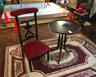 Prayer chair, scalloped table, area rug