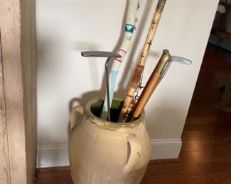 Terra cotta floor vase, walking sticks
