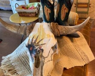 Painted cow skull, cowboy boots