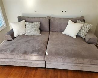 """Brand new, never-sat-on gray double  chaise sofa.  Michael Nichols designs. Retail $2,400 Estate sale price $1,200 104"""" wide 69"""" deep 33 1/2"""" tall at the back"""