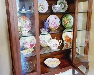 Stunning lighted antique vitrine, display, curio cabinet. It has had electricity added and is now lighted. The original wooden shelves have been replaced with grooved glass shelves for plate display.  $800 (contents sold separately - Victorian hand painted plates and teapot range $10 - $30)