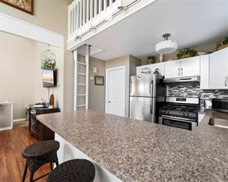 Stainless steel sink, all kitchen cabinets (upper & lower); faux-granite Formica counter tops