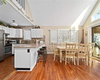 Gorgeous Pergo floating floor. Kitchen cabinets (uppers & lowers), faux granite counter tops