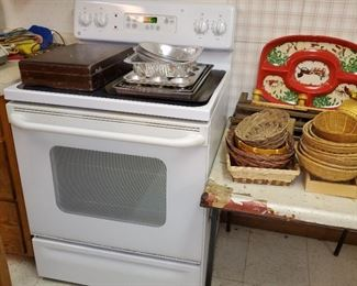 Electric Stove by GE, Flat cooktop, does not self clean. Asking $300 obo PRESELLING IF POSSIBLE