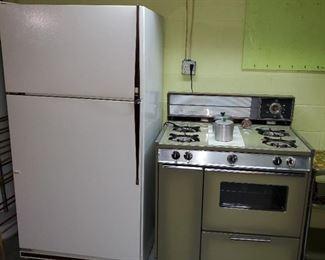 older fridge and gas stove